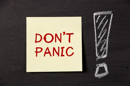 dont worry: note with big exclamatory mark on blackboard. Stock Photo