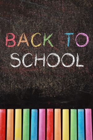 Back to school Background with some colourful chalk. photo