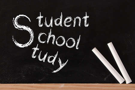 white chalks: Student, School and Study written on blackboard with two white chalks.