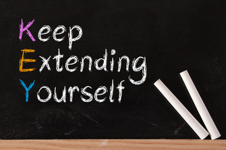 Keep Extending Yourself and KEY concept written on blackboard.