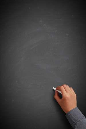 Hand writing on blank blackboard or background.