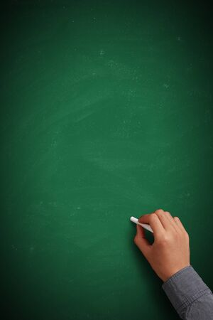 Hand writing on blank green chalkboard or background. photo