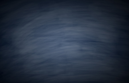 Blank blue chalkboard with chalk traces for background image. photo