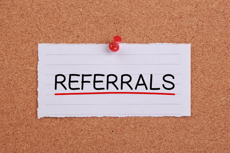 referrals: Referrals concept note paper pinned on corkboard.
