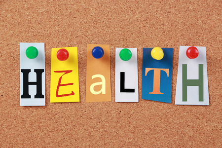 sleeping pad: The word Health in cut out magazine letters pinned to a corkboard.