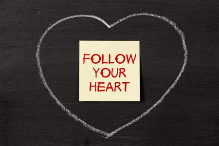 note with chalk heart on blackboard. photo