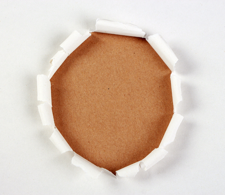 tear paper: Brown paper background under white tear paper.