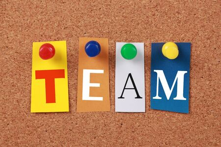 corkboard: The word Team in cut out magazine letters pinned to a corkboard. Stock Photo