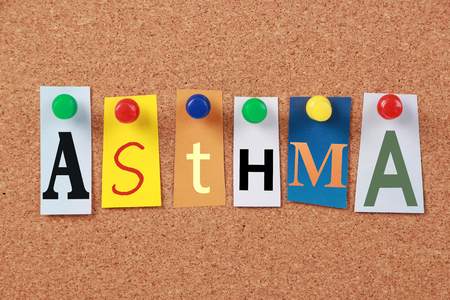 bronchial: The word Asthma in cut out magazine letters pinned to a corkboard. Stock Photo