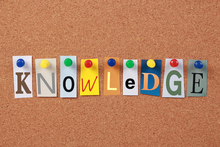 knowledge: The word Knowledge in cut out magazine letters pinned to a corkboard.