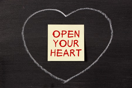 open your heart: Open Your Heart note with chalk heart on blackboard.