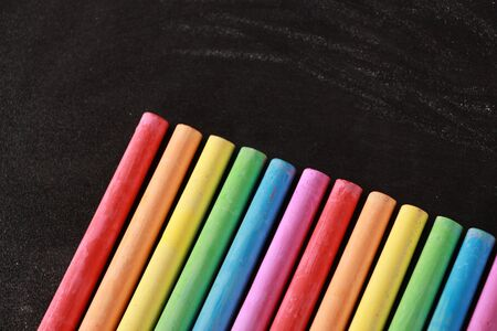 chalks: Blank blackboard background with some colorful chalks. Stock Photo
