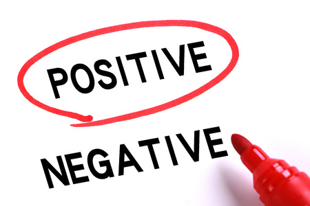 positive and negative: Choosing Positive instead of Negative with red marker. Stock Photo