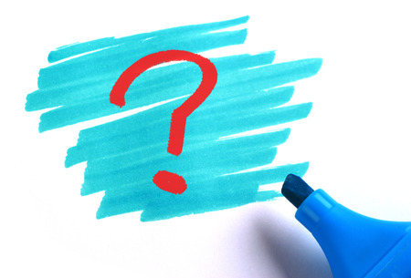 Question mark with blue marker on white background.