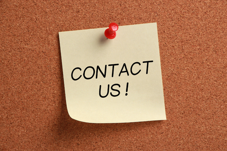 Contact Us sticky note pinned on cork.