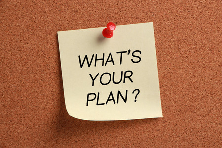 bigger picture: Whats Your Plan sticky note pinned on cork.