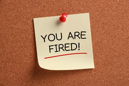 you are fired: You Are Fired sticky note pinned on corkboard.