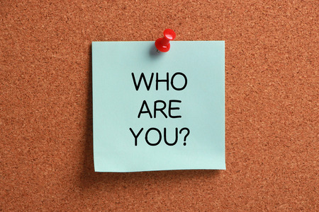 Who Are You sticky note pinned on cork. photo