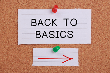 fundamentals: Back To Basic note paper pinned on corkboard.
