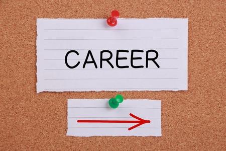 Career Ahead note paper pinned on corkboard. photo