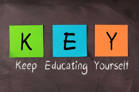 competencies: Keep Educating Yourself words with KEY notes on blackboard.