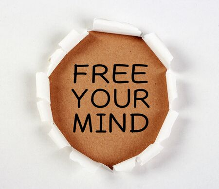 free thinking: Free your mind with tear paper on brown. Stock Photo