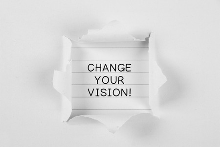 vision repair: Change your vision on brown paper with white tear paper. Stock Photo