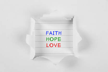 tear paper: Faith, hope, love on note paper with white tear paper.