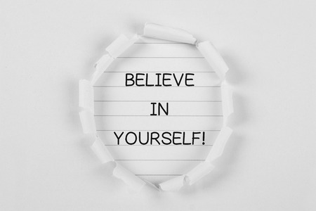 tear paper: Believe in yourself on note paper with white tear paper.