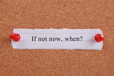 short phrase: If not now,when? note pinned on cork.