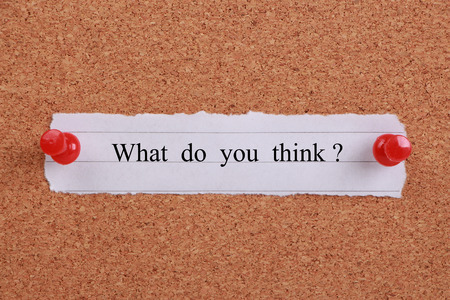 'What do you think?' note pinned on cork.