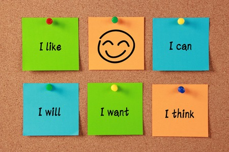 Confident Thinking sticky notes pinned on cork. photo