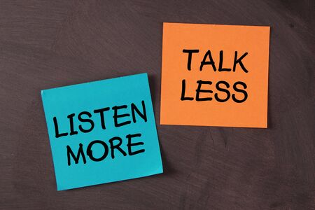less: Talk Less and Listen More notes pasted on blackboard.