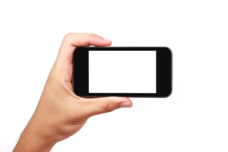 medium shot: Hand holding phone isolated on white background. Stock Photo