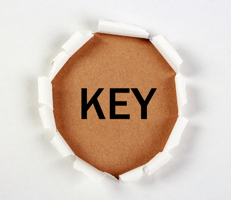 tear paper: Key concept with tear paper on brown.