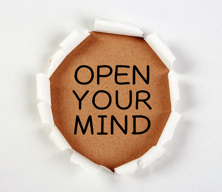 tear paper: Open your mind with tear paper on brown. Stock Photo