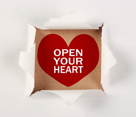 Open your heart on brown paper with white tear paper.