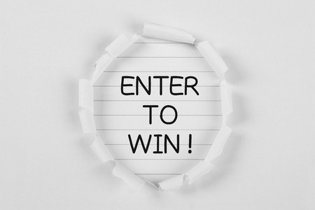 tear paper: Enter to win on note paper with white tear paper.