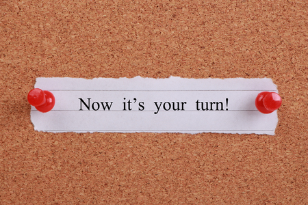 'Now it's your turn' note pinned on cork.