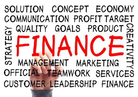 Finance word cloud is written on transparent whiteboard by the hand of a businessman. photo