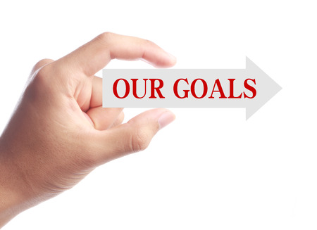 our vision: Hand is holding Our Goals arrow isolated on white background.