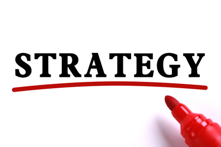 underline: Strategy text is on white paper with red underline which is written by the red marker.