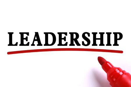underline: Leadership text is on white paper with red underline which is written by the red marker.