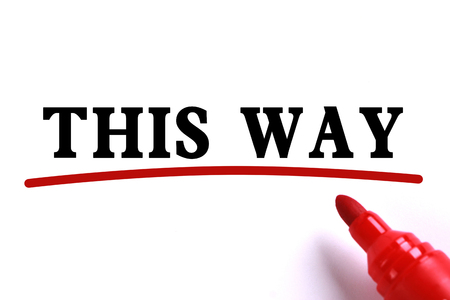underline: This Way text is on white paper with red underline which is written by the red marker.