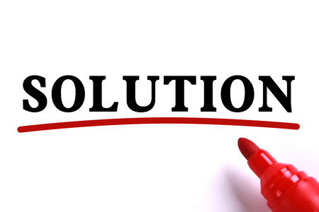 underline: Solution text is on white paper with red underline which is written by the red marker. Stock Photo