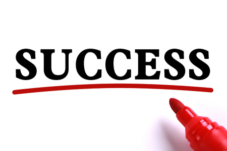 underline: Success text is on white paper with red underline which is written by the red marker. Stock Photo
