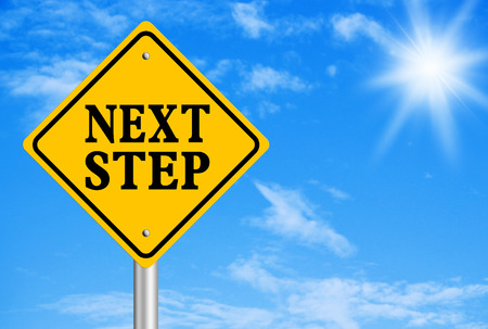 Next Step abstract is on road sign with blue sky background.