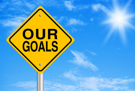our vision: Our Goals text is on road sign with blue sky background. Stock Photo