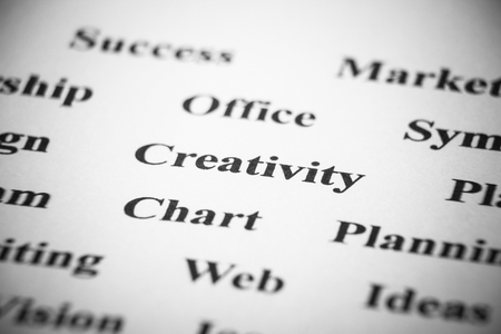 resonate: Creativity with some other related words on paper. Stock Photo