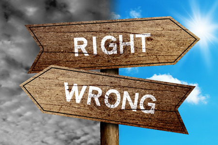 difficult decision: Right Or Wrong concept road sign with cloudy and sunny sky background.